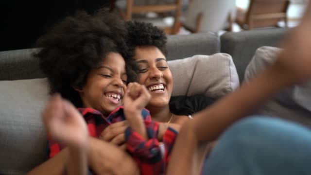 vídeos de stock e filmes b-roll de sisters playing on the couch, tickling each other - characters
