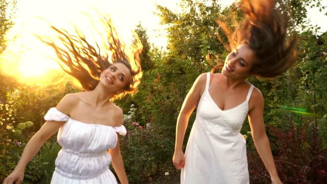 Sisters shake their hair video