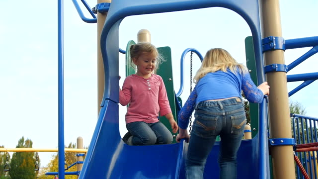 Sisters sit at the top of the slide video