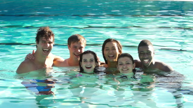 Six friends swim at an outdoor pool video