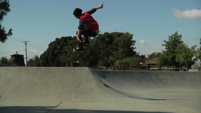 skateboard hip ollie - skateboarding stock videos and b-roll footage