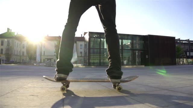 Skateboarder does flip at sunset