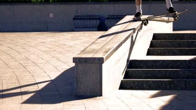Skateboarder grinding in slow motion. video