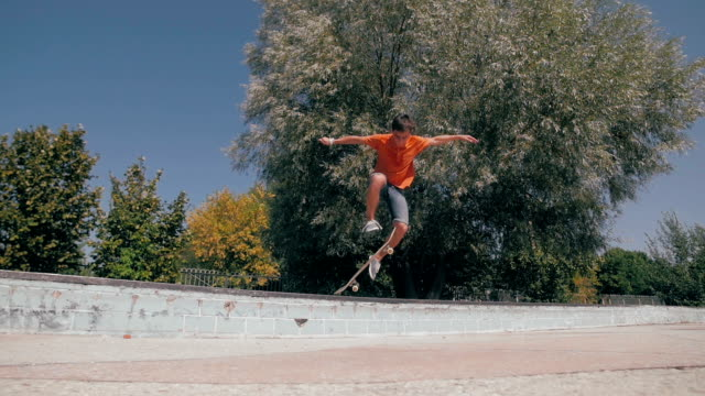 Skateboarder jumping in a city skate park. Skow motion. Steadicam shoot video