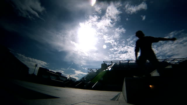 Skateboarder ollie flip in the sunshine video