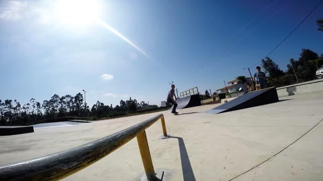 Skateboarder sliding down rail video