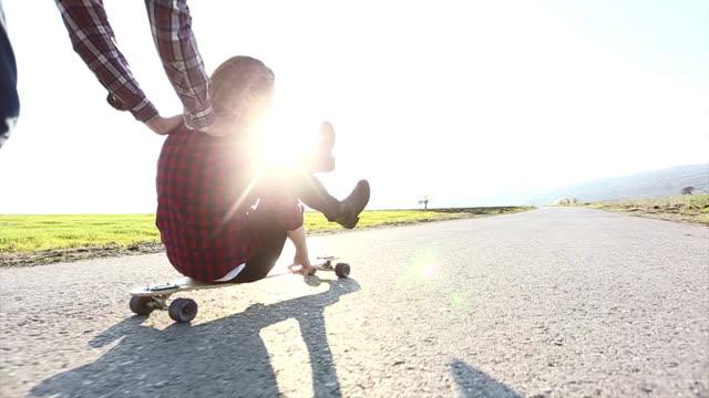 Skateboarding friends having fun