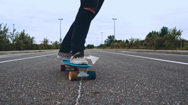 Skateboarding on a road intersection video