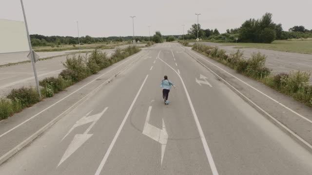 AERIAL Skateboarding on an empty parking lot video