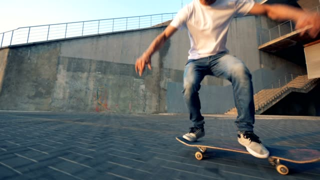 Skater falling off a board. Teenager jumps on a skateboard and falls off on a road. One skater jumps on a skateboard and falls off on a road. skateboarding stock videos & royalty-free footage