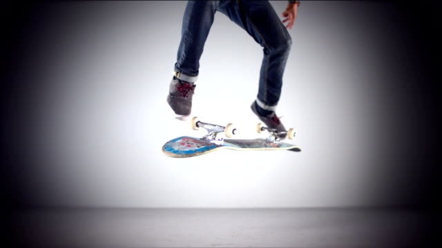 Skater rolling into kickflip trick,  Slow Motion video