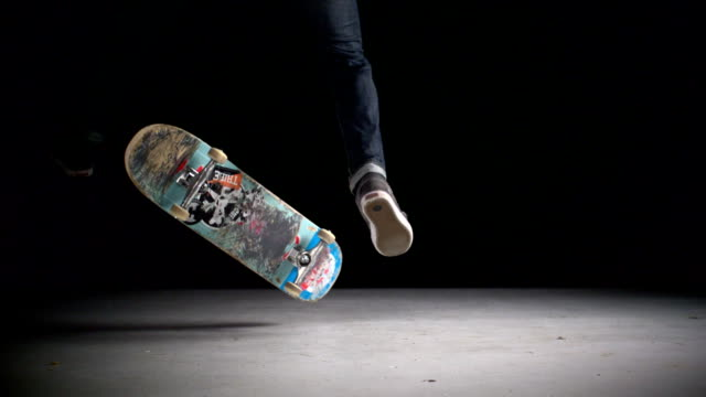 skater rolling into kickflip trick, slow motion - skateboarding stock videos and b-roll footage