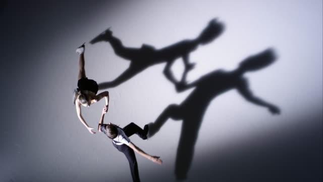 SLO MO Skating pair performing a spin pose video