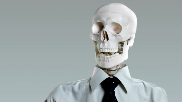 Skeletal office worker talking video