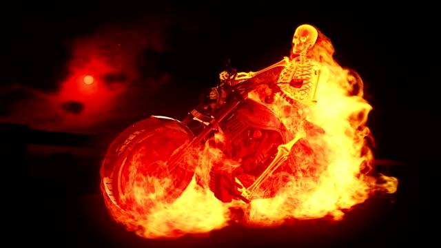 skeleton biker on fire - wheel black background bildbanksvideor och videomaterial från bakom kulisserna