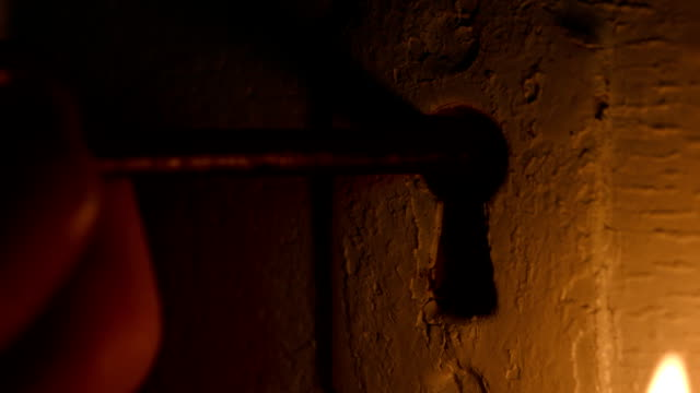 Skeleton Key Inserted In Door By Candlelight video
