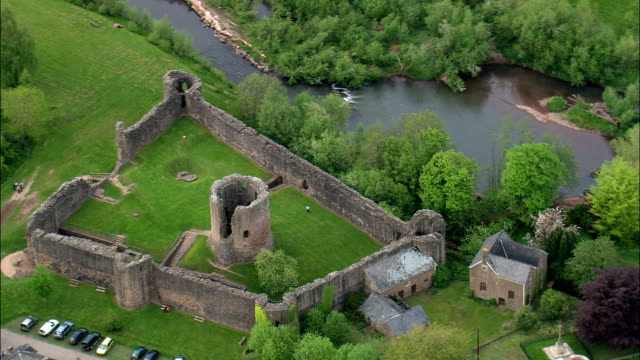 Skenfrith Castle  - Aerial View - Wales,  Monmouthshire,  United Kingdom video