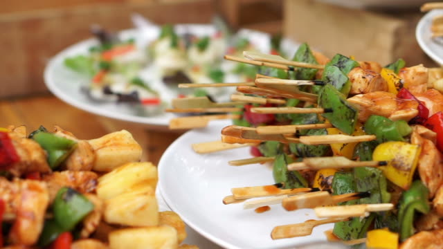 BBQ skewer and other buffet catering food set on table in event party video