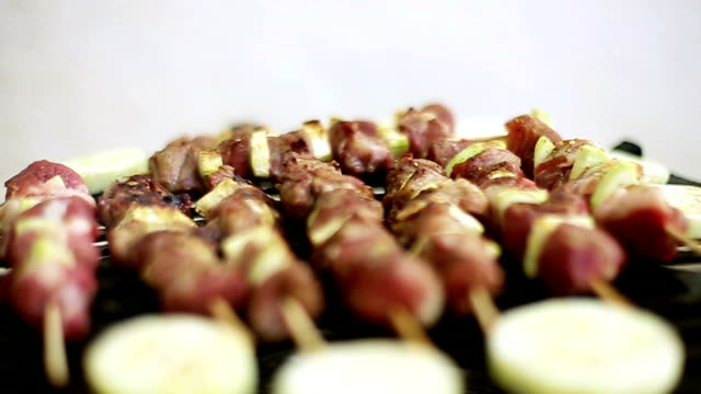Skewers on Barbecue Delicious Skewers and Cucumber Pieces on Barbecue Grill skewer stock videos & royalty-free footage