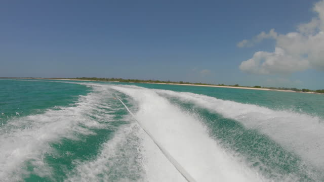 Ski Boat Wake Turks and Caicos Tropical POV POV out of ski boat in Turks and Caicos turks and caicos islands stock videos & royalty-free footage