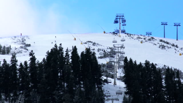 ski lift takes people to world cup ski slope top in bansko bulgaria - nature and sport background, 4k - campionato video stock e b–roll