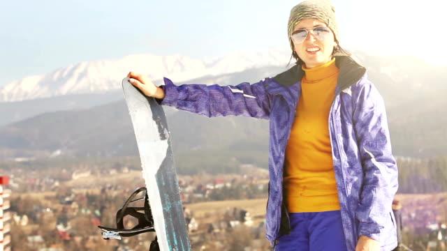 ski season in the mountains. attractive girl with snowboard . - zakopane stok videoları ve detay görüntü çekimi