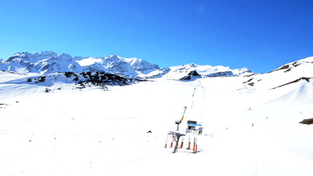 Ski Slope In Snowy Mountains, aerial view video