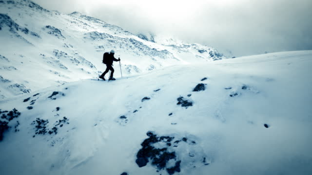 AERIAL Ski touring over the mountain ridge video