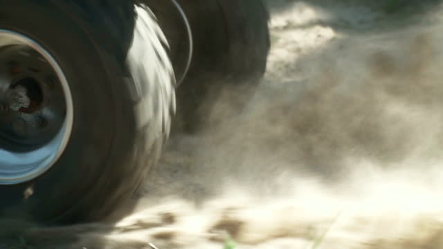 ATV skids in the sand ATV skids in the sand. The sand flies out from under the wheels, Free time spending of adrenaline lover. Extreme sports in the open air stick plant part stock videos & royalty-free footage