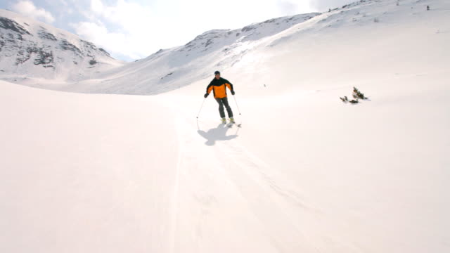 skier carving behind camera video
