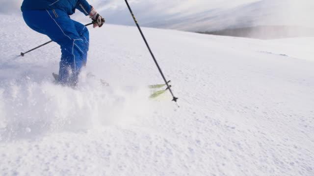 SLO MO Skier carving down ski slope video