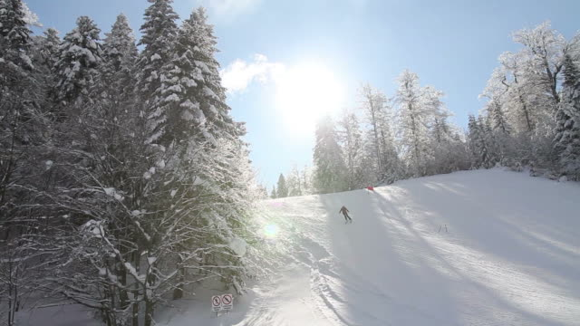 A skier skiing downhill slalom - the shot moves from the left to the right video
