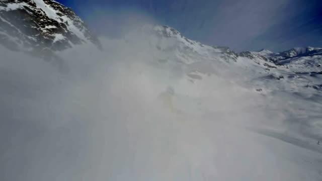 skier splashing snow on camera video