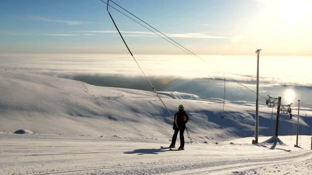 Skier using t bar ski drag lift