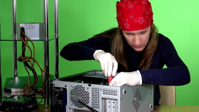 Skilled girl with headscarf repairing desktop pc. Computer repair service