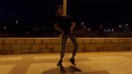 istock Skilled performer dancing under a street light 1194201747