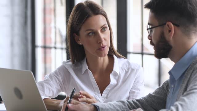 vídeos de stock e filmes b-roll de skilled smart female mentor leader helping instructing young male intern. - duas pessoas