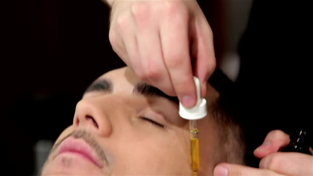 Skillful barber nourishes the skin with vitamins video