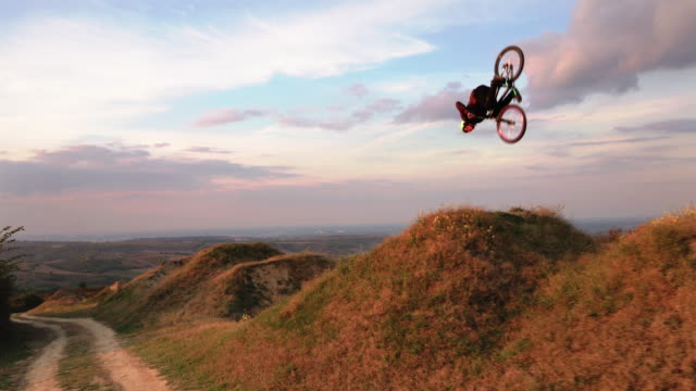 Skillful man on mountain bicycle practicing on extreme terrain. video