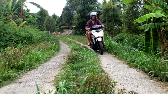 A skillful motorcycle rider driving in the mountains and jungles of Bali video