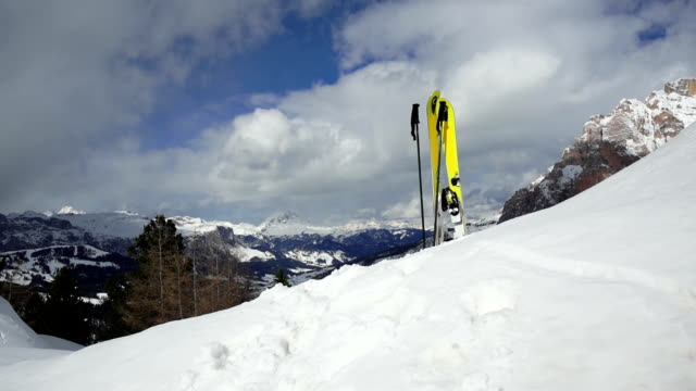 Skis Standing in Snow on Mountain Top PAN video