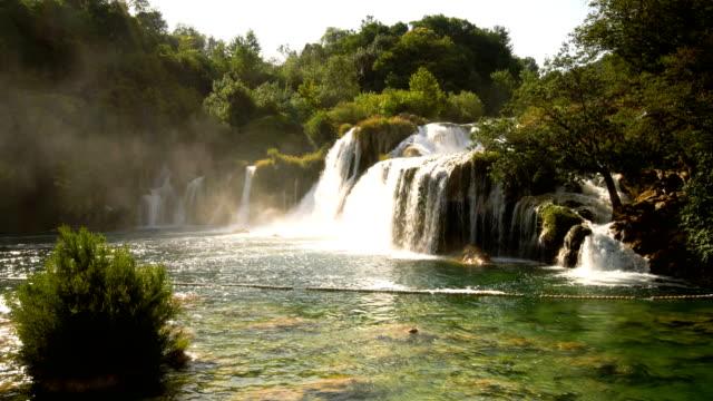 skradinski buk waterfall in krka , croatia - национальный парк плитвицкие озёра стоковые видео и кадры b-roll
