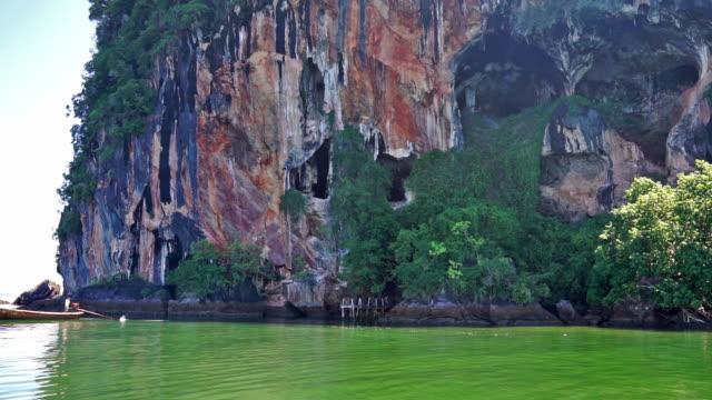 skull island, face in the rock, ko pee, krabi, thailand - mitologia video stock e b–roll