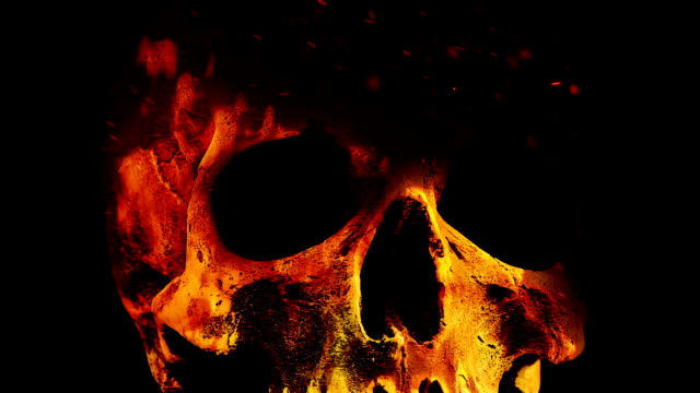 Skull Rotates In Flames Abstract Closeup Human skull rotating illuminated by raging fire skull stock videos & royalty-free footage