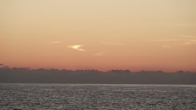 sky after sunset over sea surface - пелопоннес стоковые видео и кадры b-roll