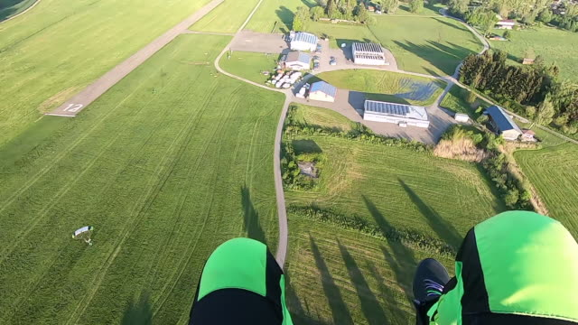 POV of sky diver landing in grassy field