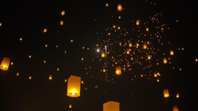 slo mo sky lantern in loi krathong traditional festival. - sky lantern stock videos and b-roll footage