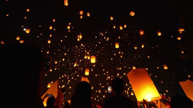 sky lantern loi krathong traditional festival. - sky lantern stock videos and b-roll footage
