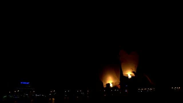 Sky lanterns at night video