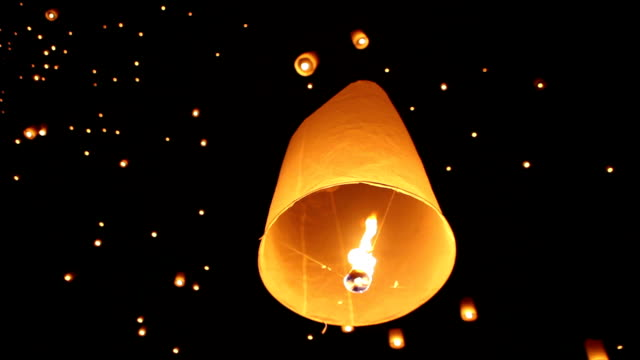 Sky Lanterns during Festival in Chiang Mai Thailand Sky lantern floating in the air during the Loy Krathong festival in Chiang Mai, Thailand. lantern stock videos & royalty-free footage